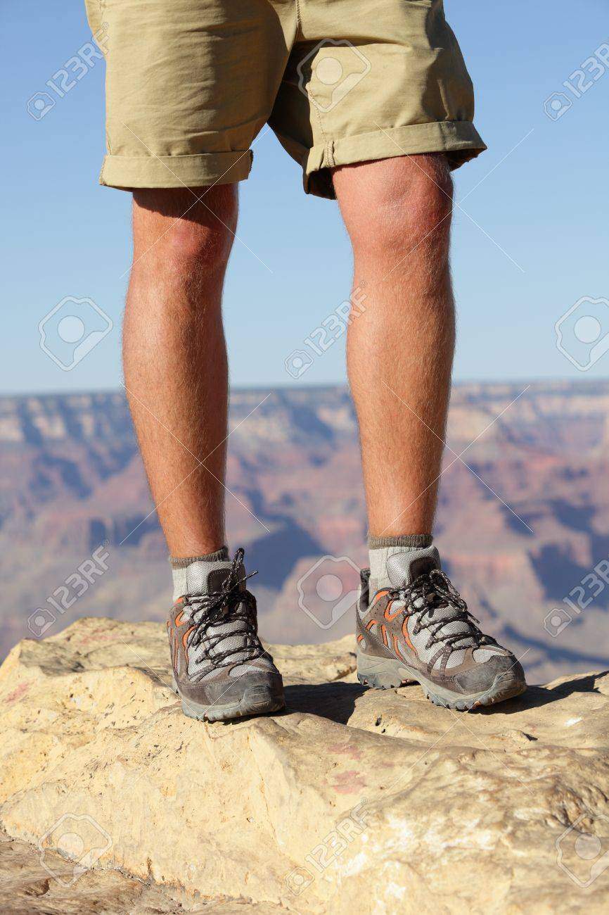 Hiking shoes on hiker in Grand Canyon. Man hikers hike boots in closeup with breathtaking view of Grand Canyon in the background. Male feet. Stock Photo - 19359132
