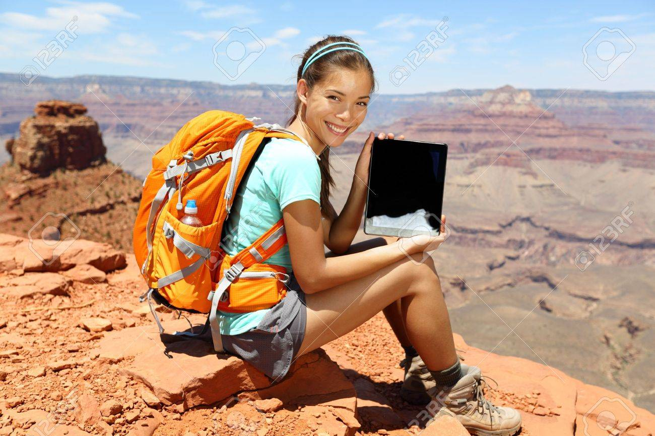 Tablet Computer Woman Hiking In Grand Canyon Showing Using Travel – Map Usa Grand Canyon