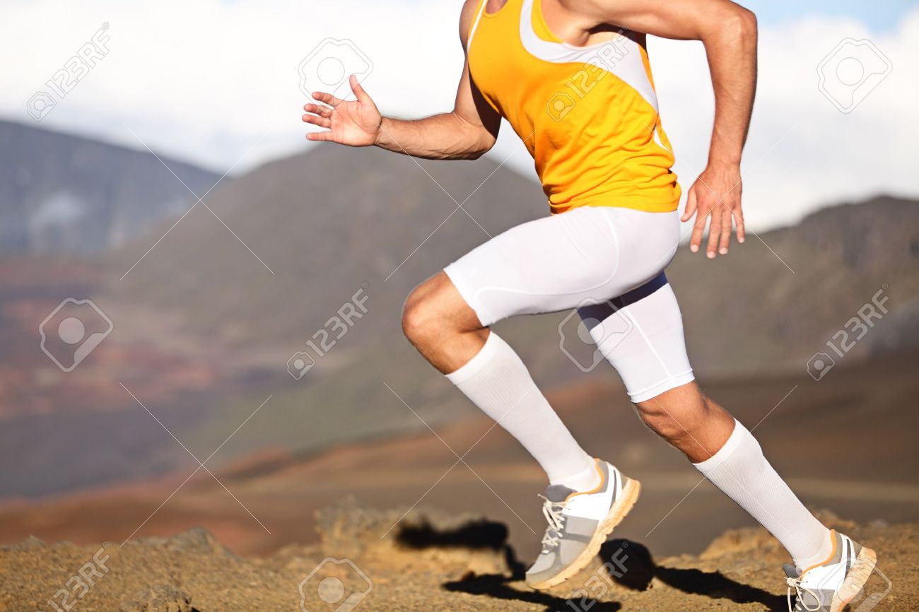 Running sport fitness man. Closeup of strong legs and shoes in action. Male athlete fitness runner sprinting fast outside in compression sports clothing, socks and tights shorts. Trail running concept Stock Photo - 20617345