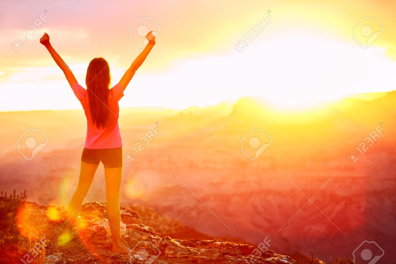 Freedom and adventure - woman happy in Grand Canyon. Free cheering girl with arms raised enjoying serene sunset in winning pose with arms stretched after hiking. Female model in Grand Canyon, USA. - 23265344