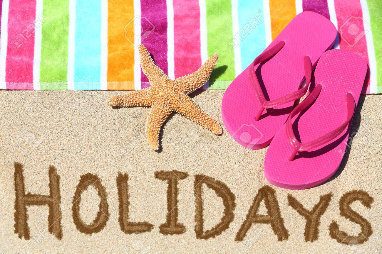 Sandals shoes holidays - Holidays Beach Travel Text Concept Holidays Written In Sand With Water Next To Beach Towel