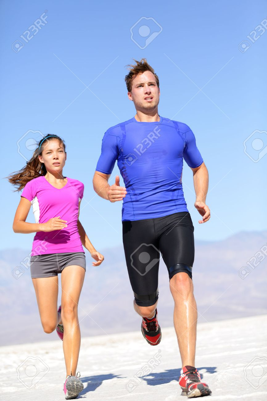 e4fe8876976c1 Marathon running athletes couple training in desert. Fitness sport runners  living active lifestyle. Fit