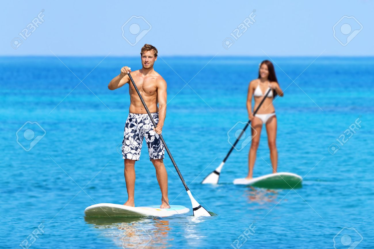 Paddleboard Beach People On Stand Up Paddle Board Surfboard Surfing In Ocean Sea Big Island