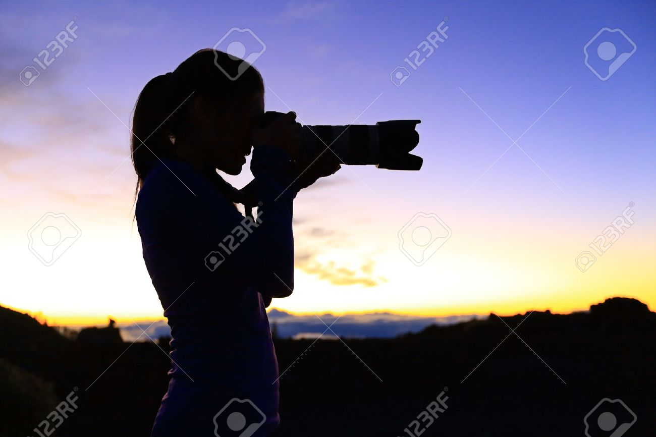 grapher Taking With SLR Camera At Night Nature