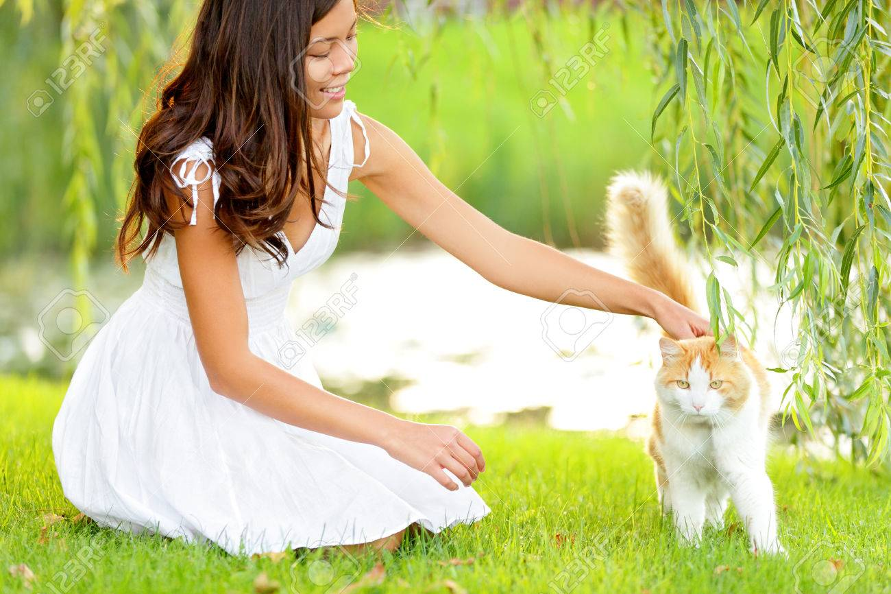Woman Petting Cat In Summer Park Happy Cute Girl Playing With Stock Photo Picture And Royalty Free Image Image 26735435