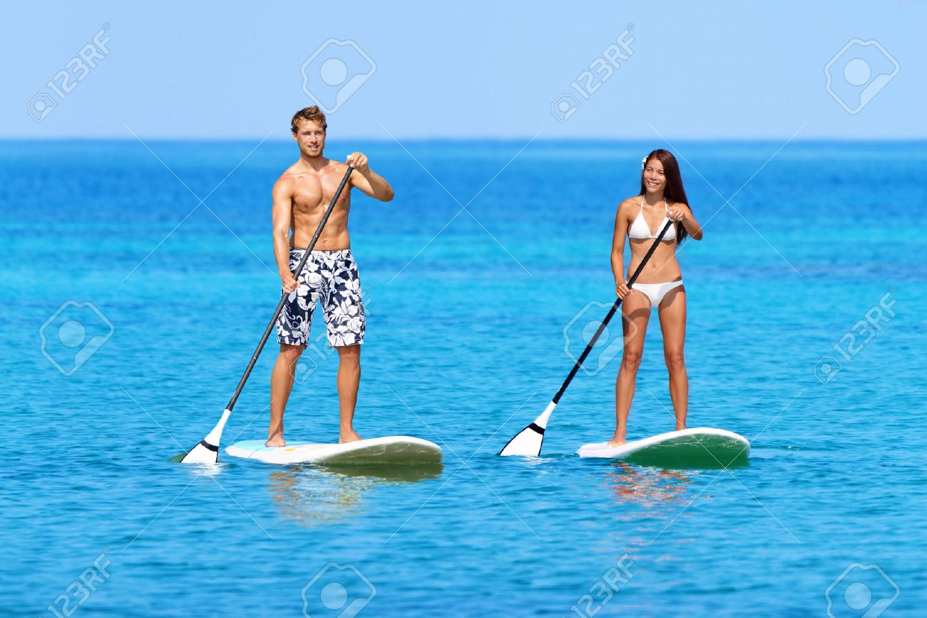 Stand Up Paddleboards >> Stand Up Paddleboarding Beach People On Stand Up Paddle Board