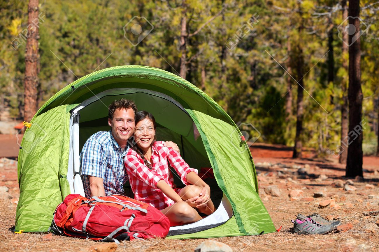 People c&ing in tent - happy backpacking couple in forest. C&ers smiling happy outdoors in  sc 1 st  123RF.com & People Camping In Tent - Happy Backpacking Couple In Forest ...
