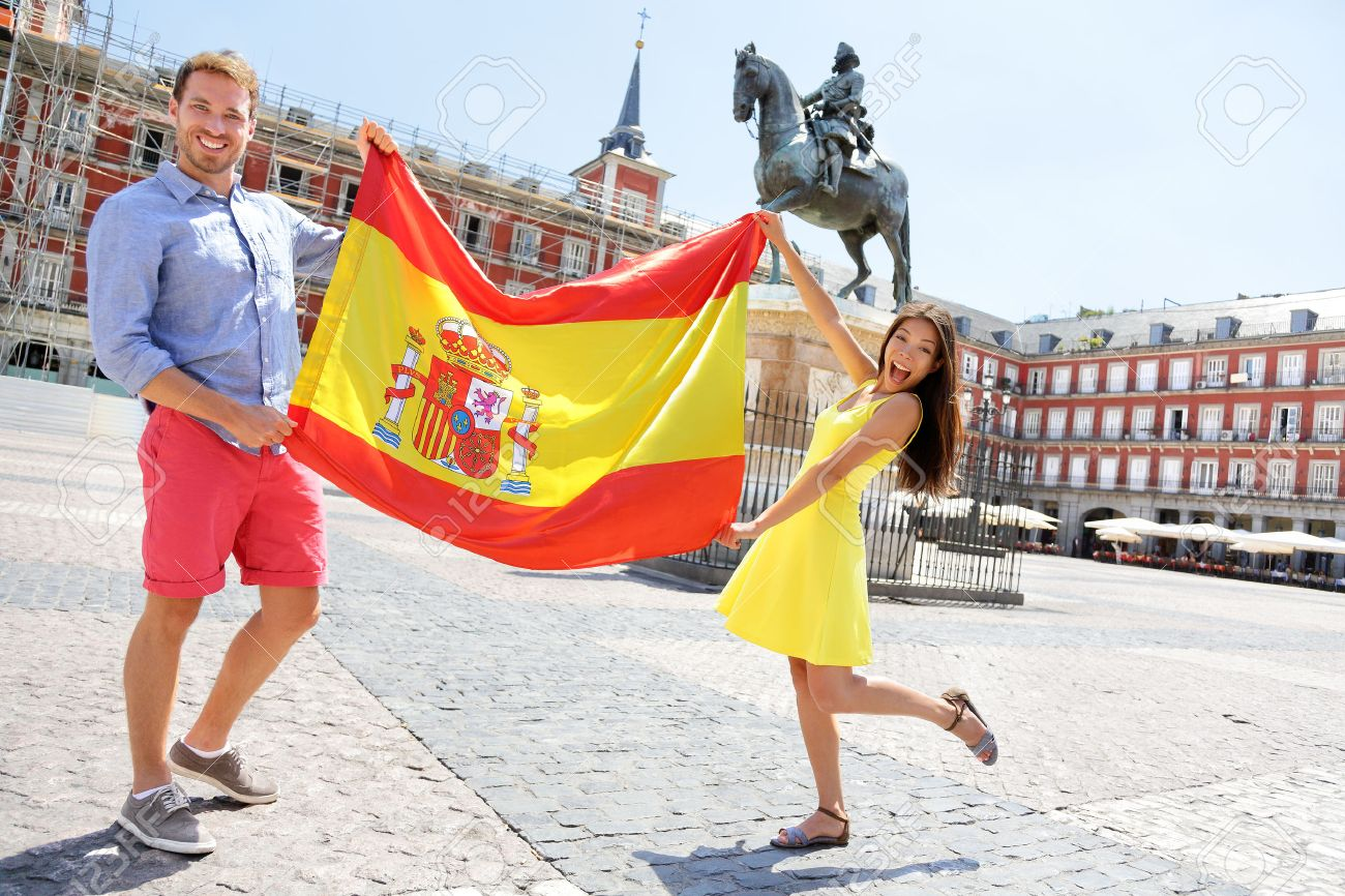 spanish flag people showing spain flag in madrid on plaza mayor