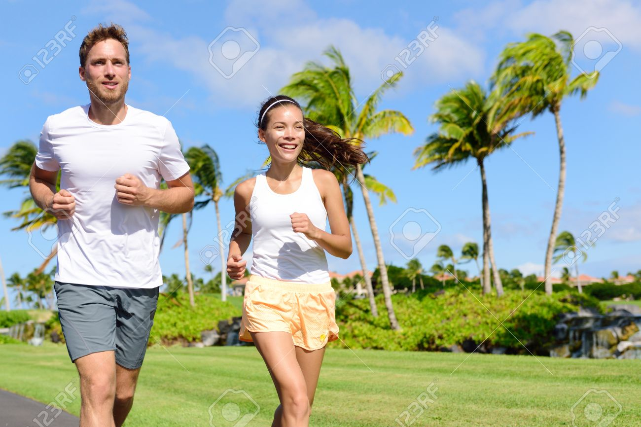 People Running In City Park Happy Young Couple Living An Active