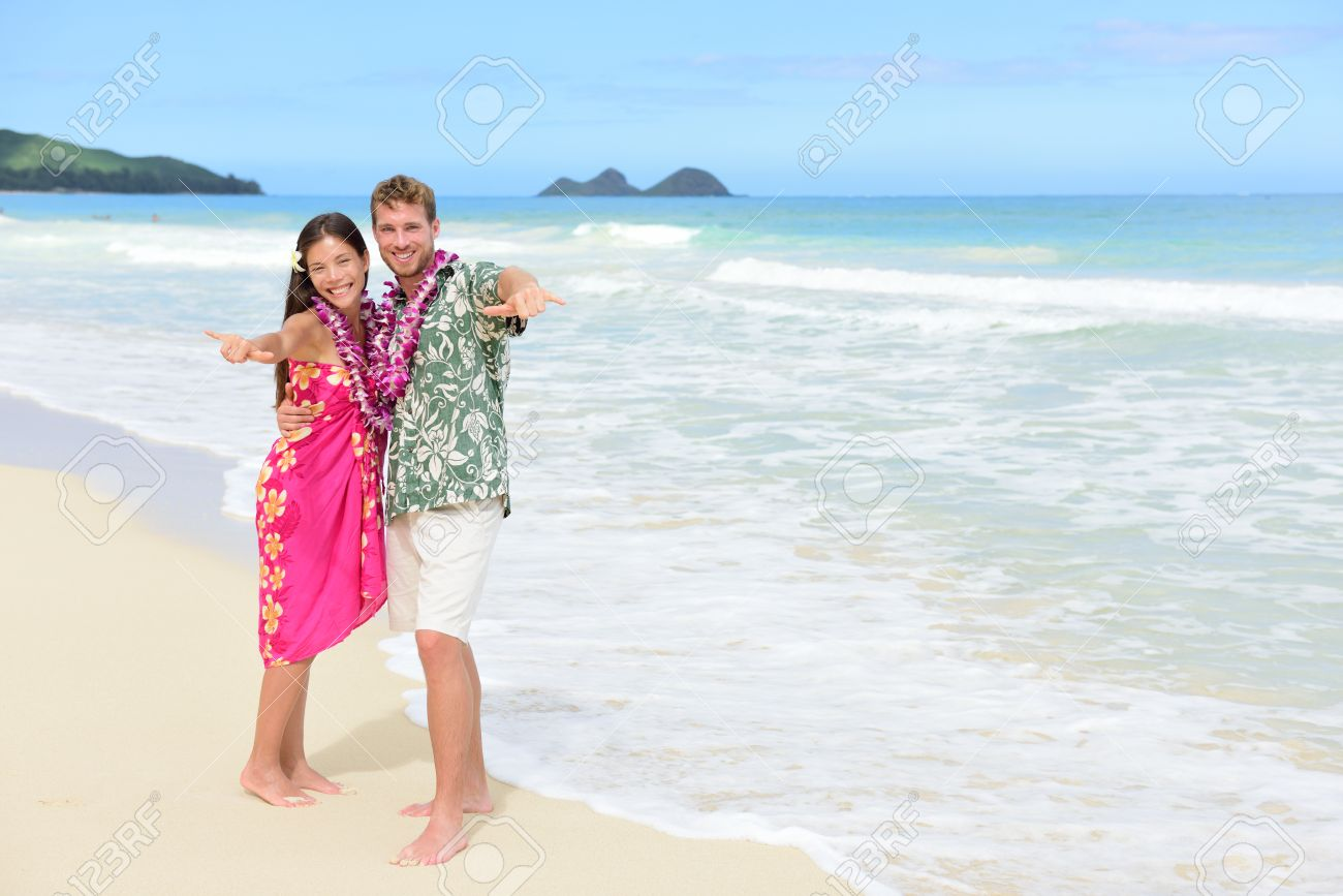 Portrait Of Couple Tourists Happy Standing On Hawaiian Beach At Their Hawaii Vacation Asian