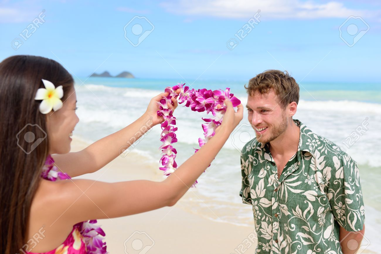 Hawaii woman giving lei garland of pink orchids welcoming tourist hawaii woman giving lei garland of pink orchids welcoming tourist on hawaiian beach portrait of izmirmasajfo Images
