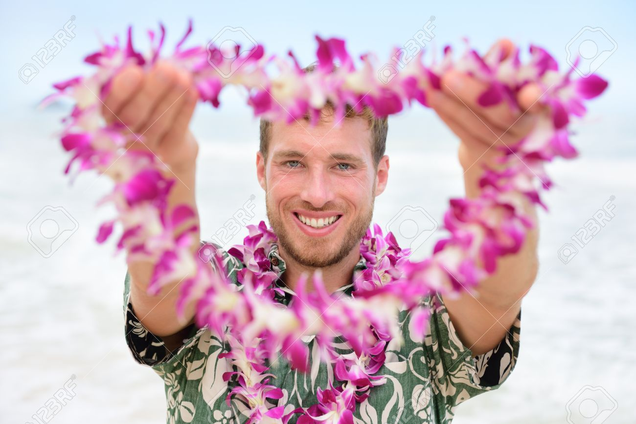 Hawaii caucasian man with welcome hawaiian lei male tourist stock hawaii caucasian man with welcome hawaiian lei male tourist portrait holding flower necklace giving it izmirmasajfo Image collections