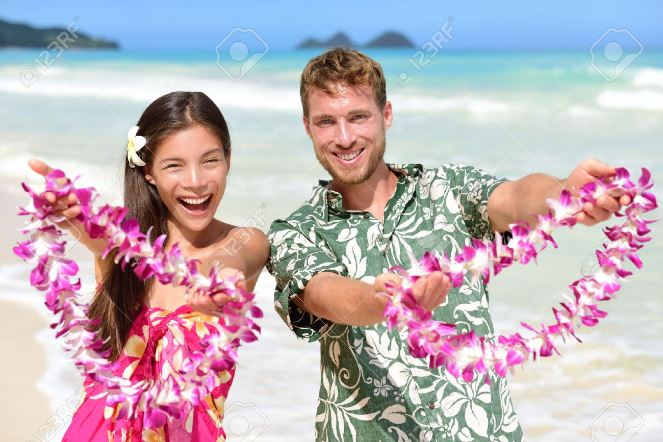 Hawaiian people showing giving leis flower necklaces as welcoming hawaiian people showing giving leis flower necklaces as welcoming gesture for tourism stock photo izmirmasajfo Image collections