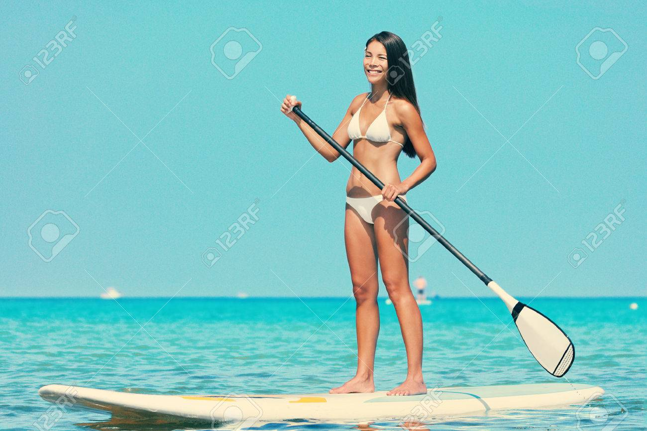 4ee160cb698 Stand up paddle board woman paddleboarding on SUP on Hawaii standing happy  on paddleboard on in