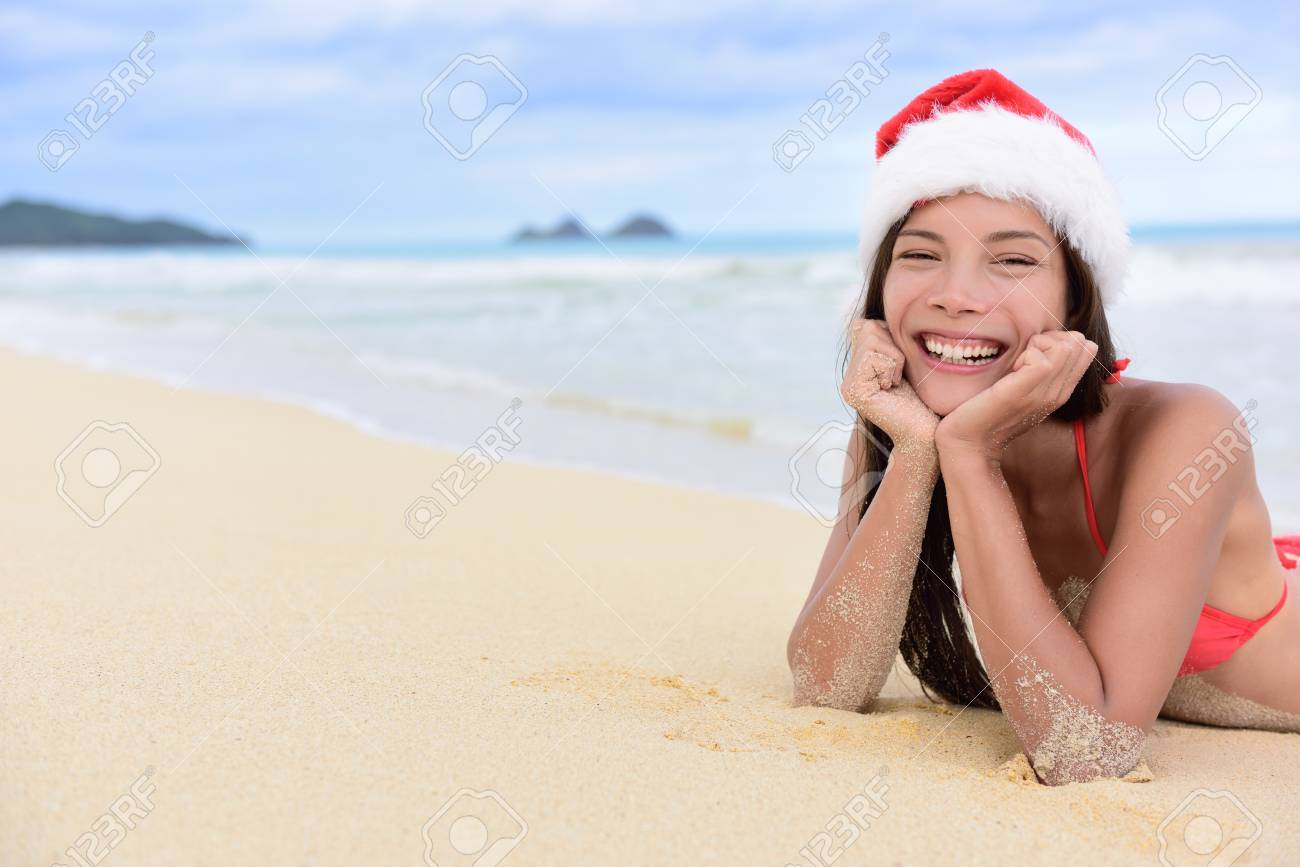 Christmas beach vacation - cute mixed race Asian Chinese girl