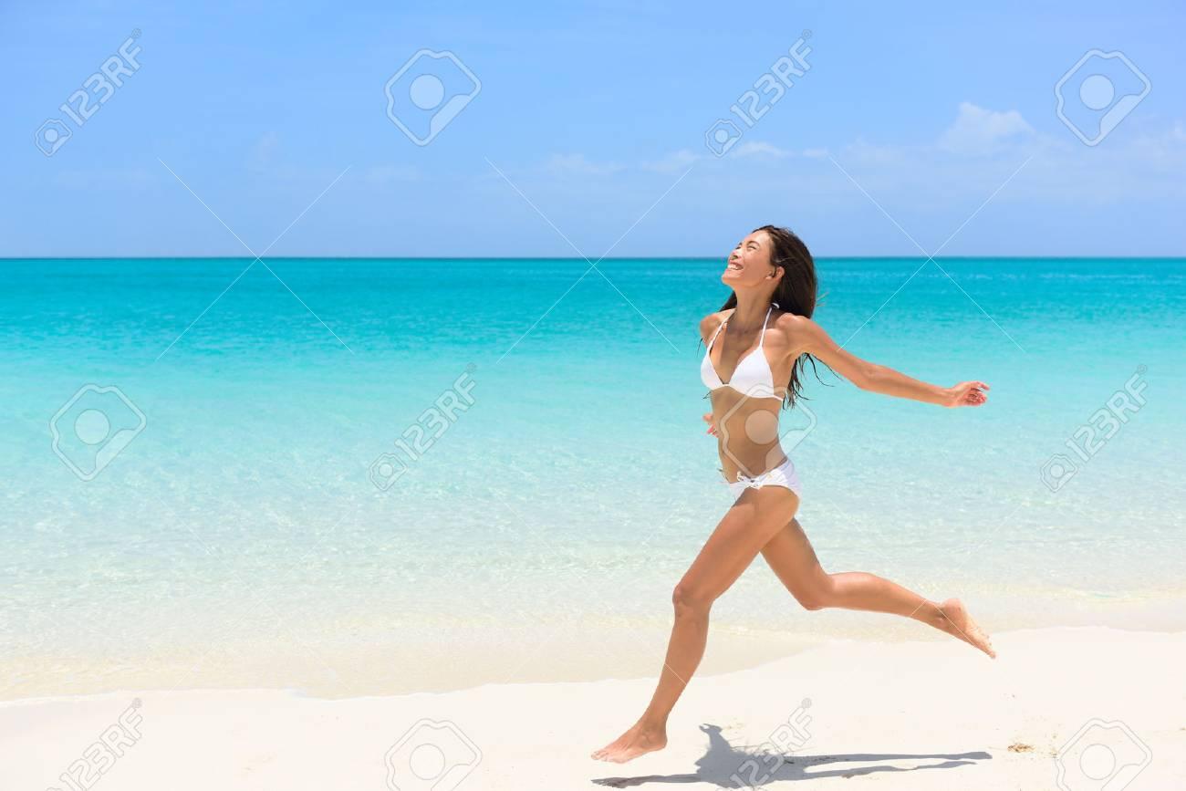 Beach Bikini Woman Carefree Running In Freedom Fun Joyful Happy Asian Girl Relaxing Showing Joy