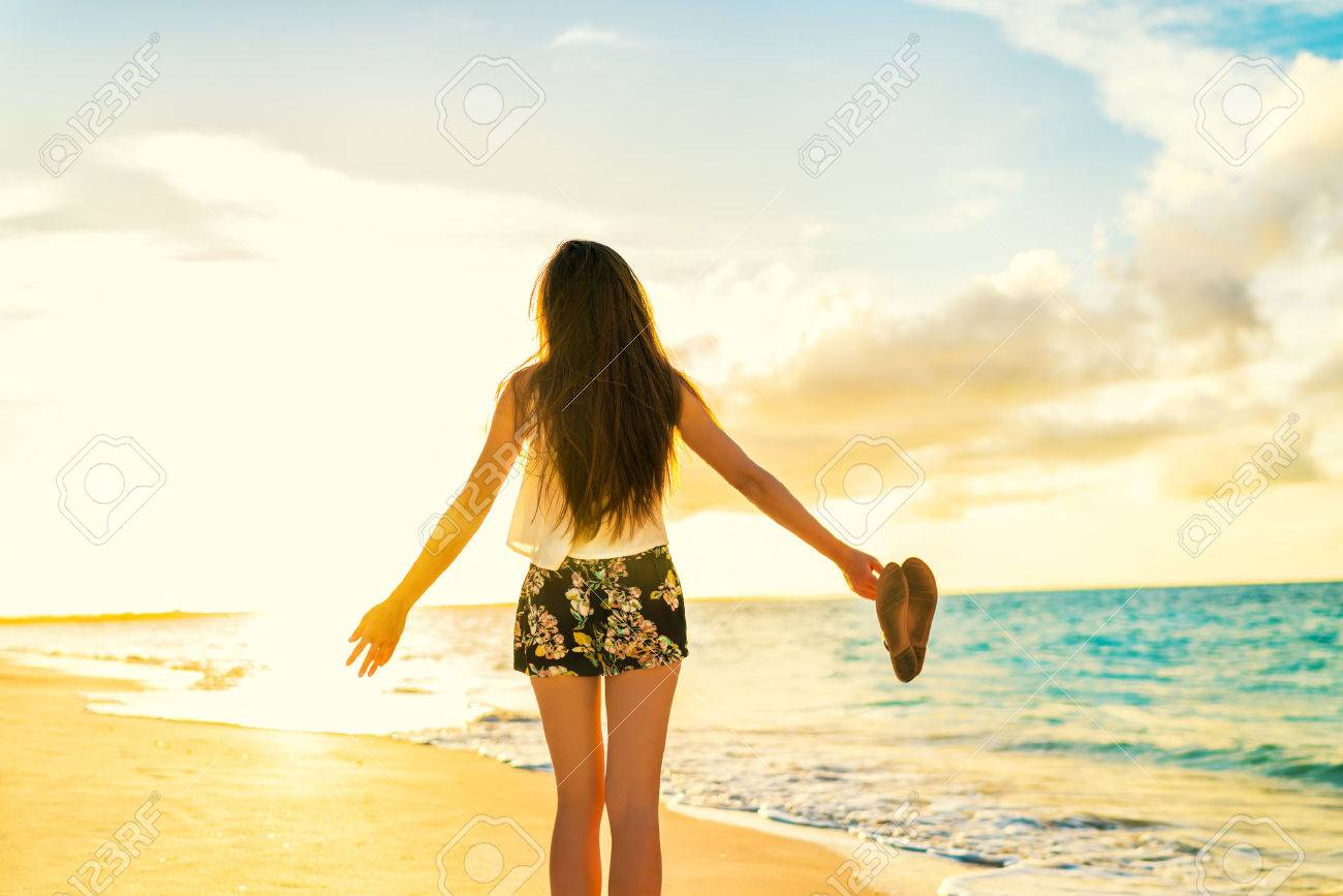 Freedom woman carefree dancing relaxing on beach in sunset. Young people summer lifestyle vacation travel. Vitality healthy living concept. - 55651568