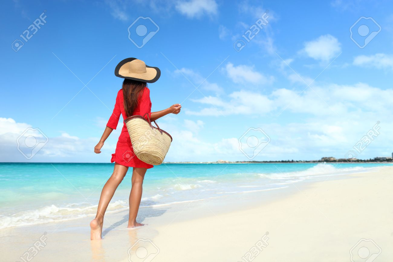 Beachwear woman tourist with straw sun hat and beach bag walking on  tropical summer vacation wearing 131140290a4