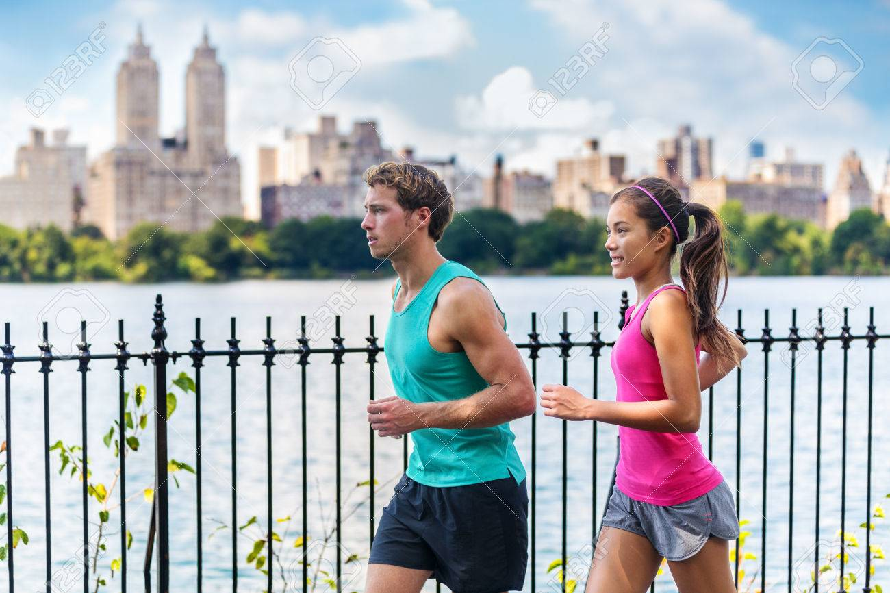 0b3c9ced80517 Running couple runners jogging in Central Park, NYC livng healthy fitness  lifestyle. People running