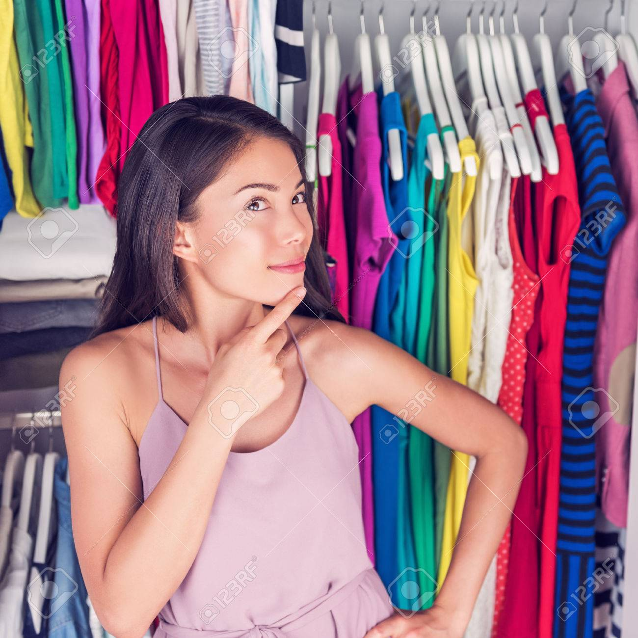 Home Closet Or Store Clothing Rack Changing Room. Woman Choosing Her  Fashion Outfit. Shopping
