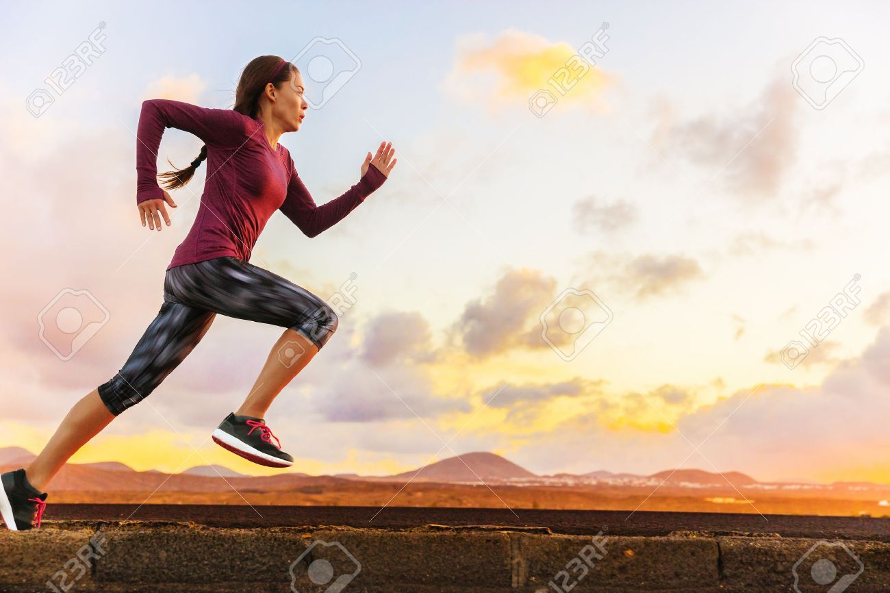 Athlete trail running silhouette of a woman runner at sunset sunrise. Cardio fitness training of marathon race sportswoman. Active healthy lifestyle in summer nature outdoors. Stock Photo - 57254452
