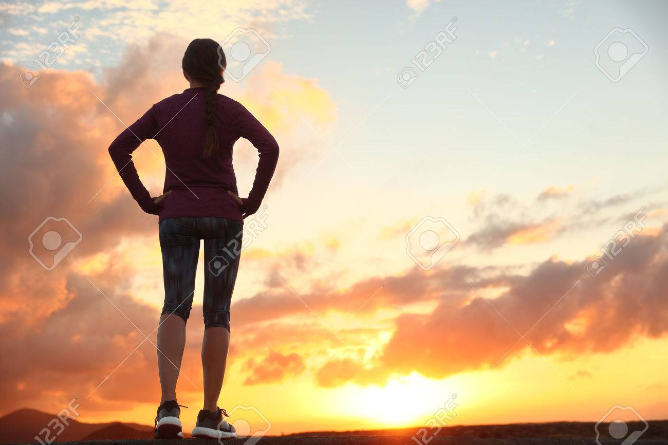 Active woman looking ahead at sunset sky for life challenge stock active woman looking ahead at sunset sky for life challenge runner athlete getting ready for thecheapjerseys Image collections