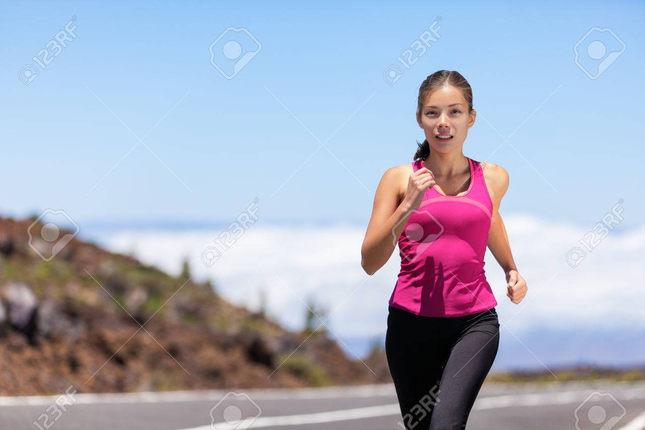 7d1f2e0dca61 Fit sport athlete running woman runner jogging outdoor on road training for  marathon race run.
