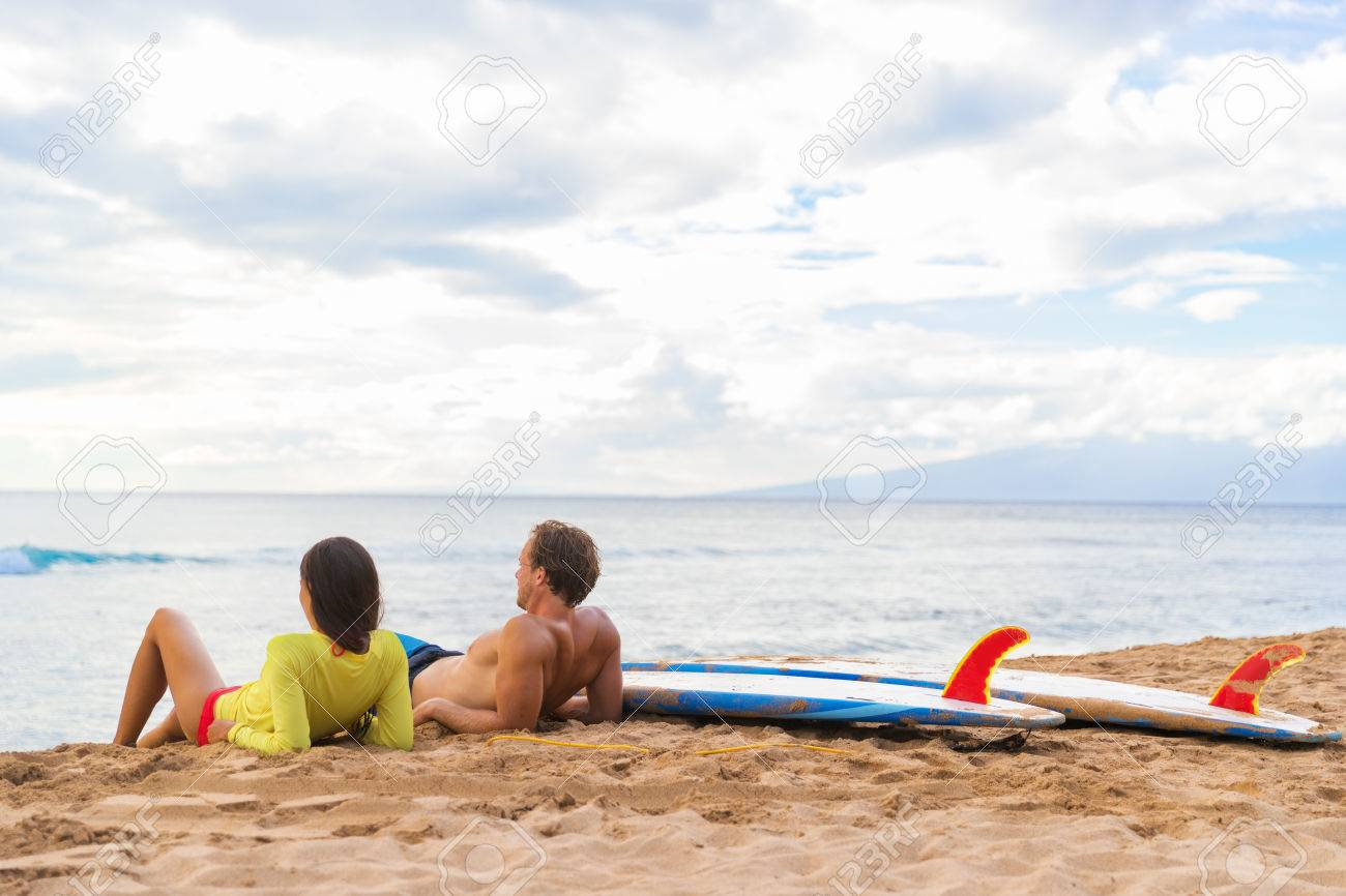 Couple Surfers Relaxing After Surfing On Hawaiian Beach Two People Lying Down Sand