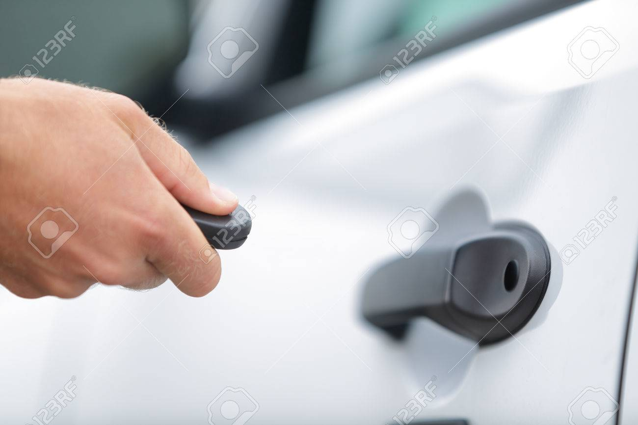 Man driver locking doors with unlock keyless system. Person & Car Remote Control Key Fob. Man Driver Locking Doors With Unlock ...