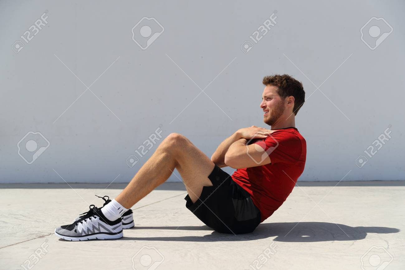 Fitness Man Doing Sit Ups Bodyweight Floor Exercises At Gym