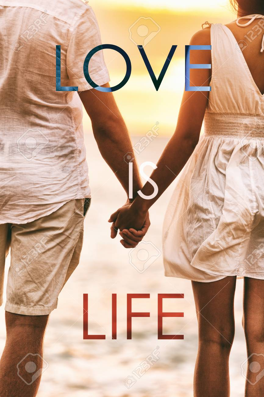 love is life title written over couple in love holding hands at sunset beach honeymoon holidays