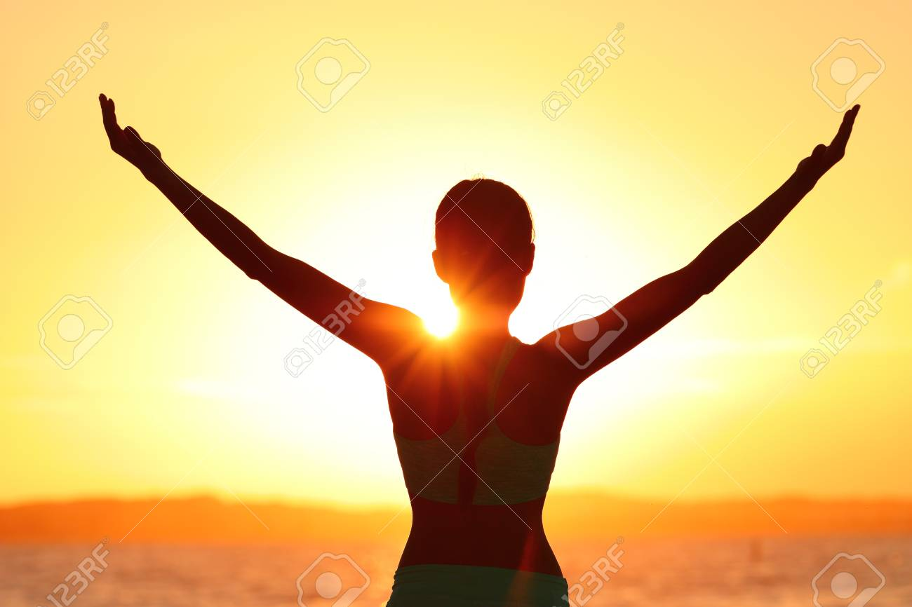 Freedom woman with open arms silhouette in sunrise against sun flare. Morning yoga girl practicing sun salutation outdoors. Carefree person living a free life. Success freedom happy life concept. - 93511784