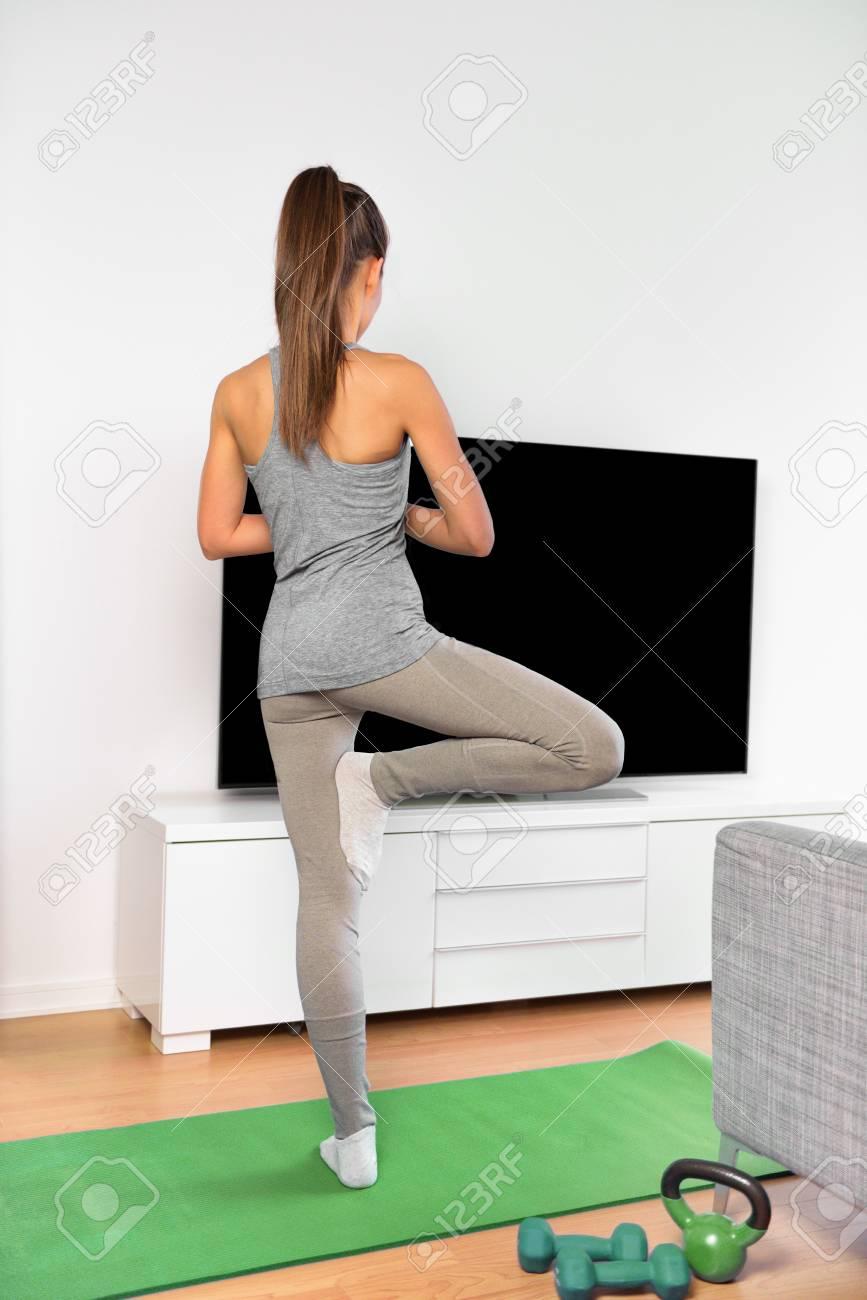 Yoga video fitness class - woman exercising training balance