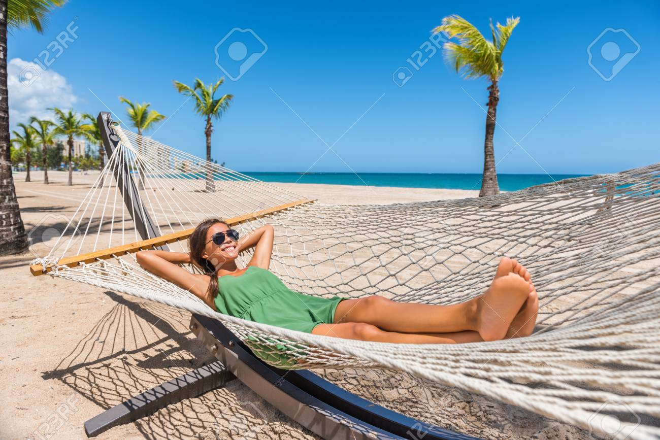Happy Girl Relaxing On Beach Hammock In Tropical Vacation Resort Hotel.  Holidays In The Caribbean