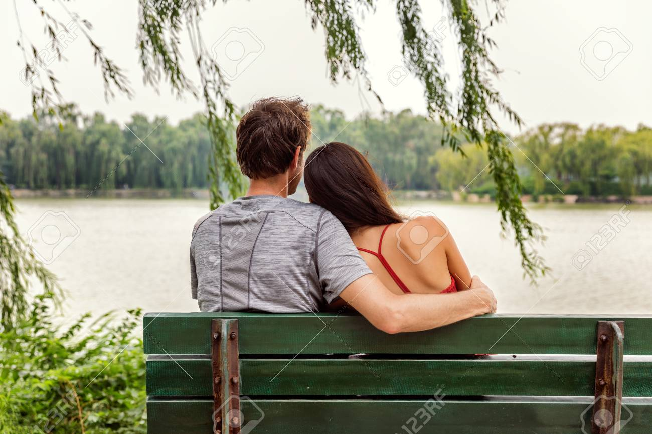 Couple In Love Two Young Lovers Sitting Together On A Park Stock