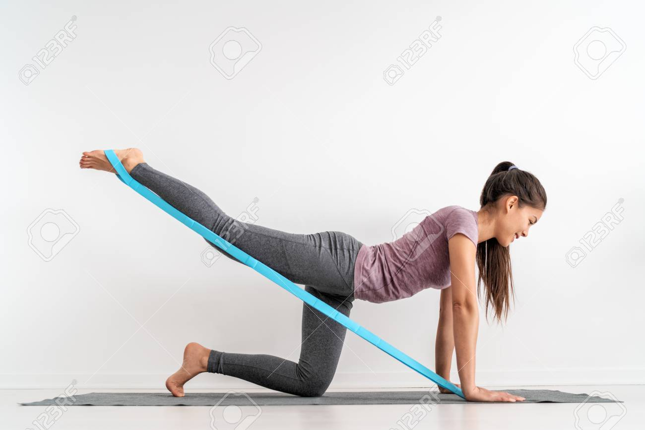 Resistance Band Fitness Girl Doing Leg Workout Donkey Kick Floor