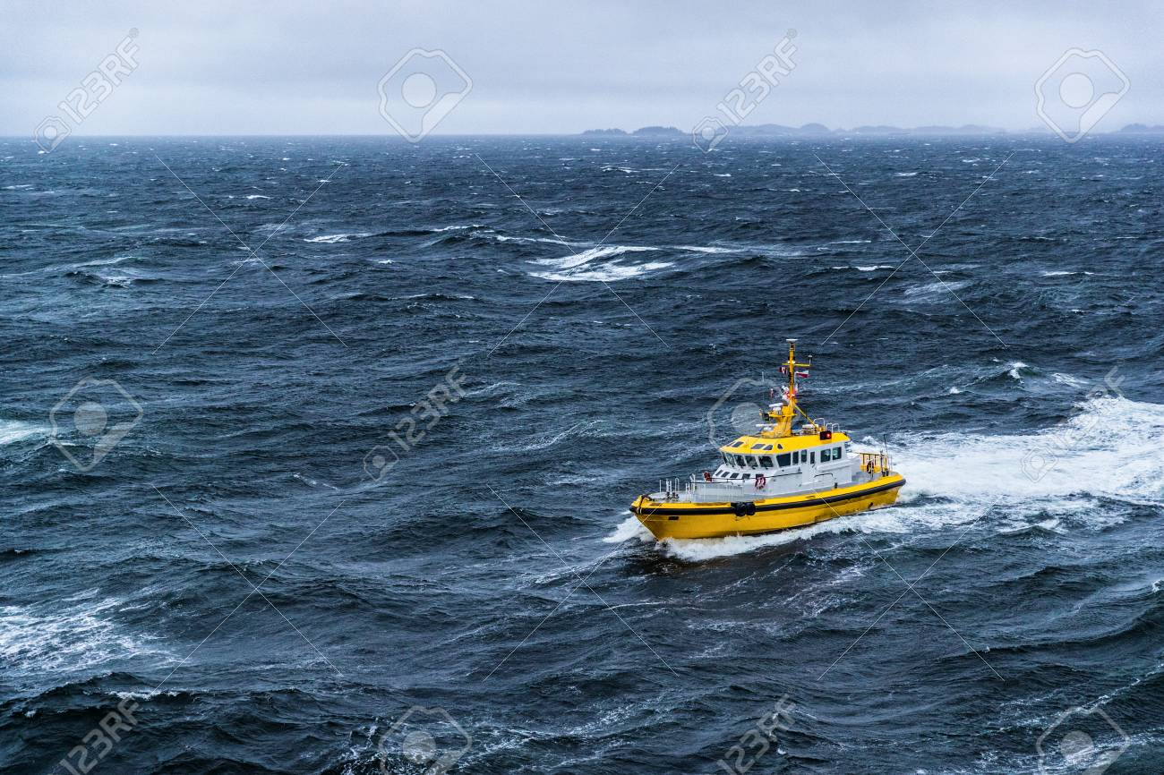 Coast guard boat patrol riding on rough sea waves in Alaska. - 117197228