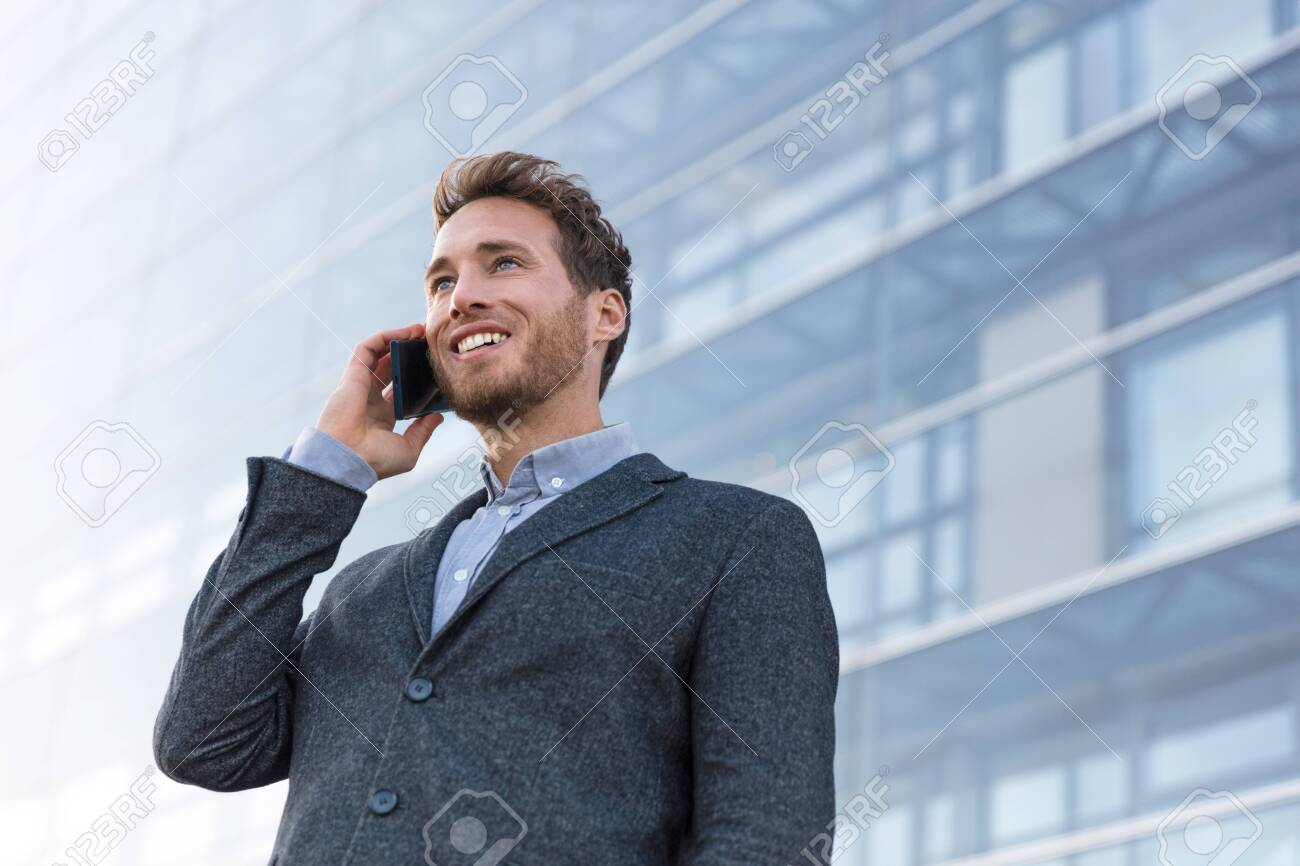 Man professional talking on phone calling business partner. Businessman real estate agent or lawyer having negotiation conversation in modern city background. - 121627302