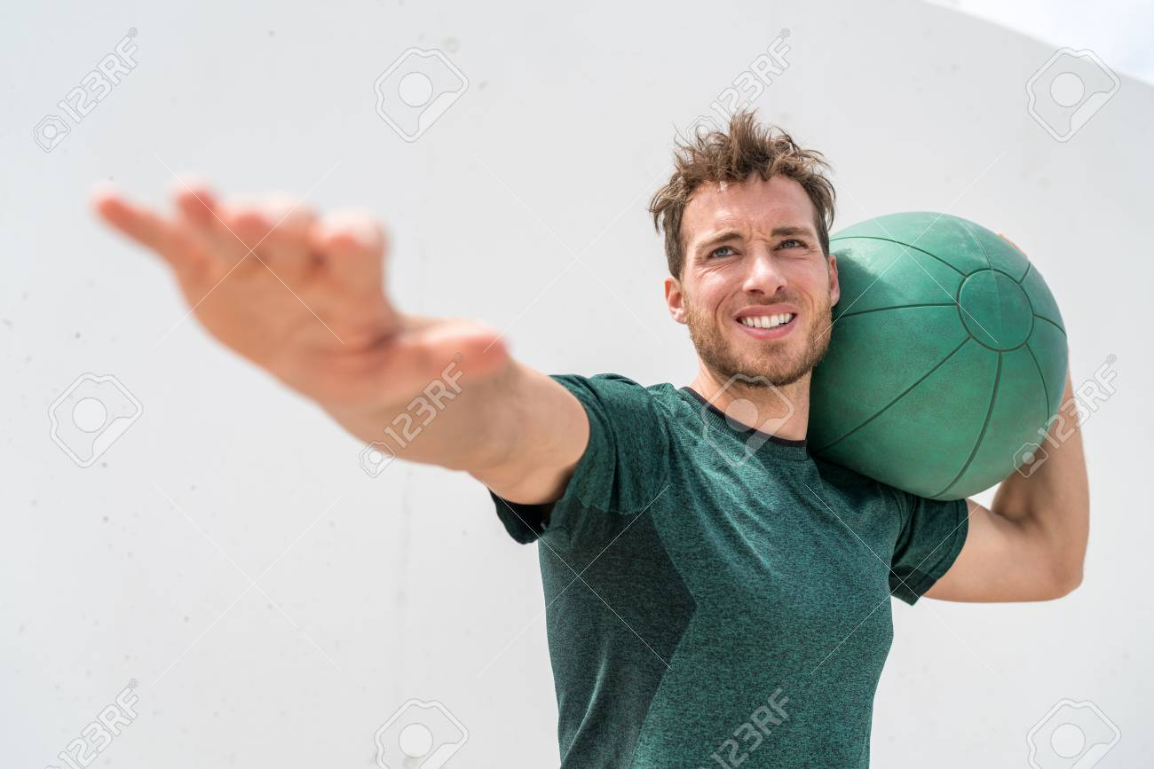Medicine ball heavy weighted ball workout man training in outdoor