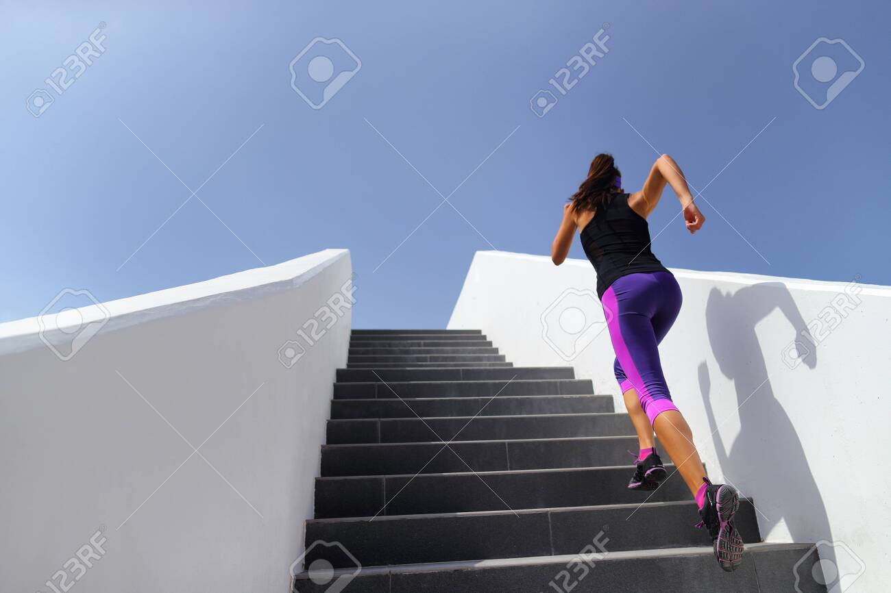 Stairs running workout woman training cardio at gym. Fitness girl exercising legs muscles outdoors with explosive exercises. - 123999775
