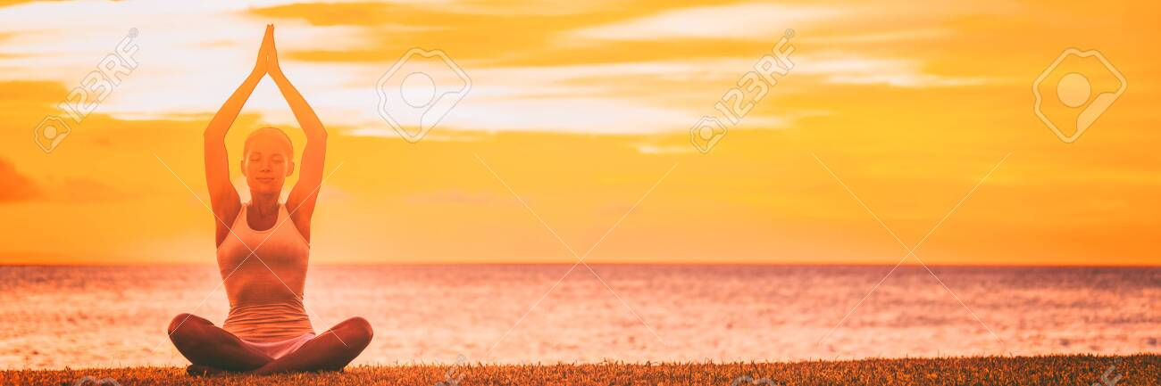 Yoga Meditation Banner Background Woman Meditating On Sunset Stock Photo Picture And Royalty Free Image Image 125036627