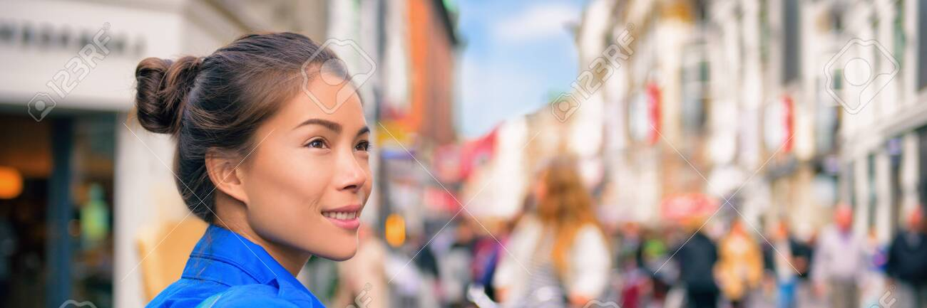 Tourist travel Asian woman walking on city street looking at shops visiting Europe. Banner panorama lifestyle. - 131455866