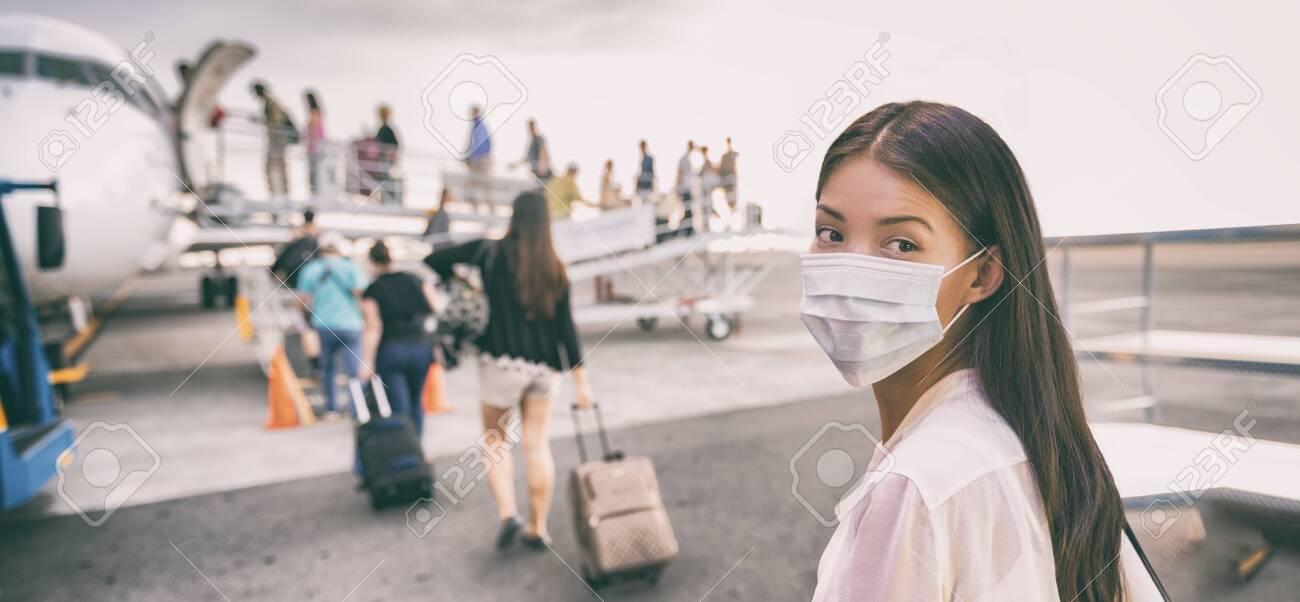 Airport Asian woman tourist boarding plane taking a flight wearing face mask. Coronavirus flu virus travel concept banner panorama. - 139898544
