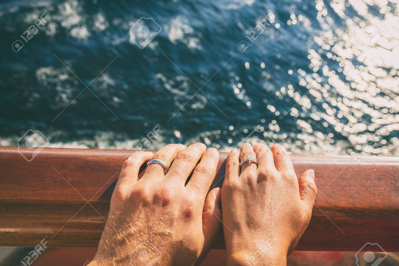 It is a photo of Cruise travel honeymoon married couple. Newlyweds woman and man..