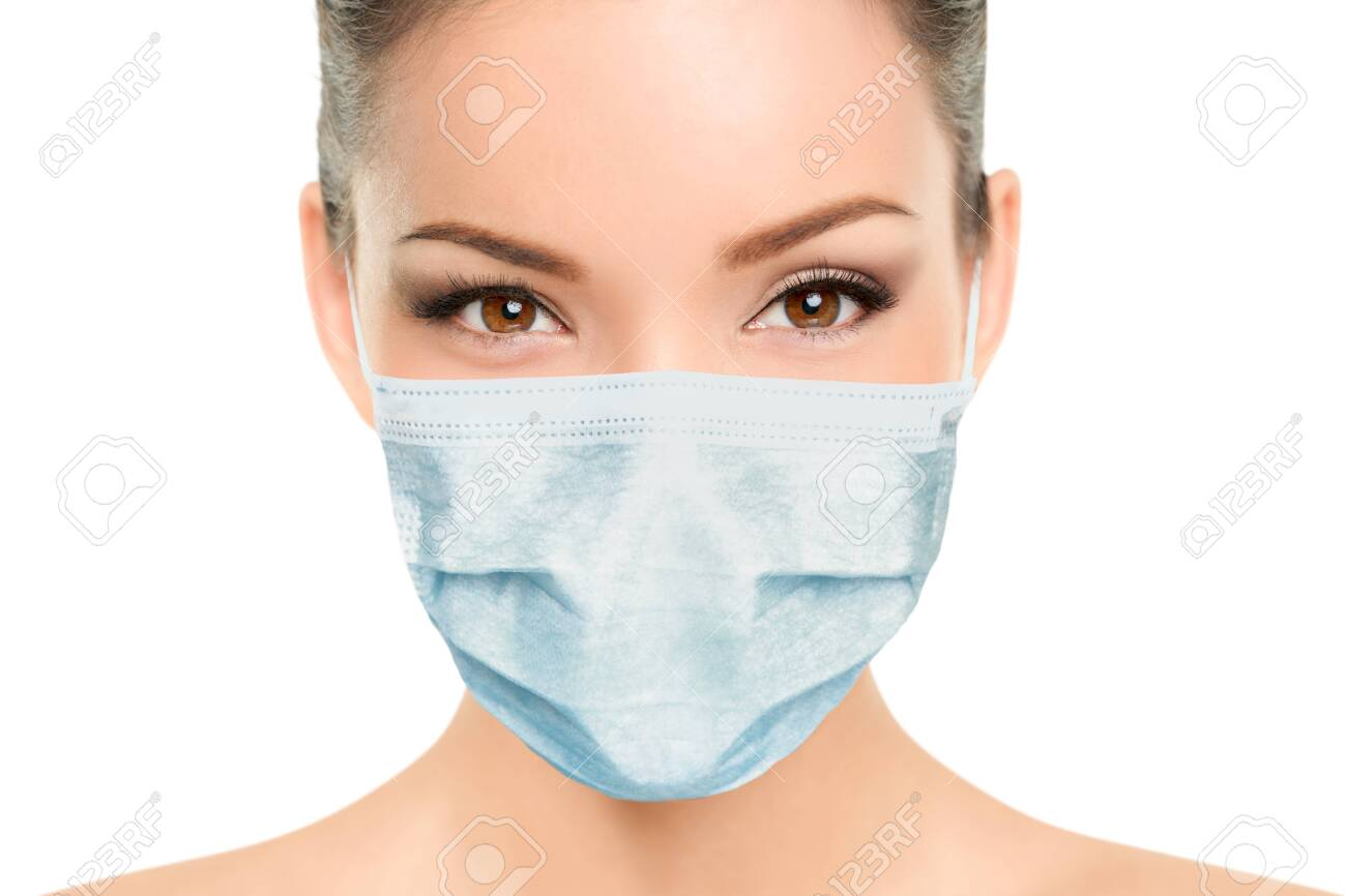 Beautiful Asian woman wearing medical face mask with eyes makeup beauty model portrait isolated on white background for Coronavirus. - 147857375