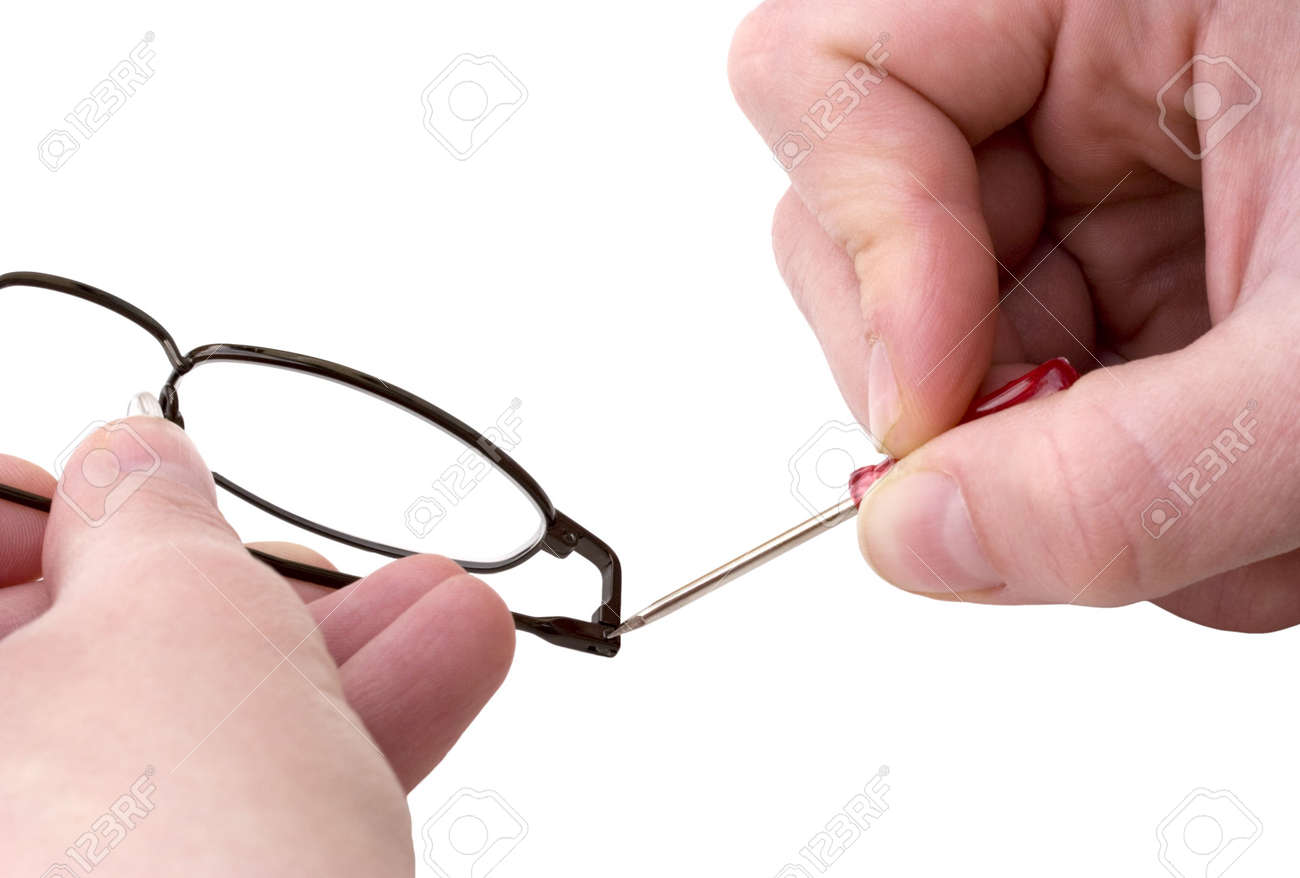 Hands Holding A Mini Screwdriver Tightening A Loosened Nut On Stock Photo Picture And Royalty Free Image Image 255735