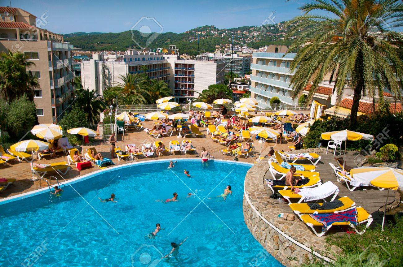 Hotel pool with people  Lloret De Mar, Spain - June 15, 2011 - People Enjoy Themselves ...