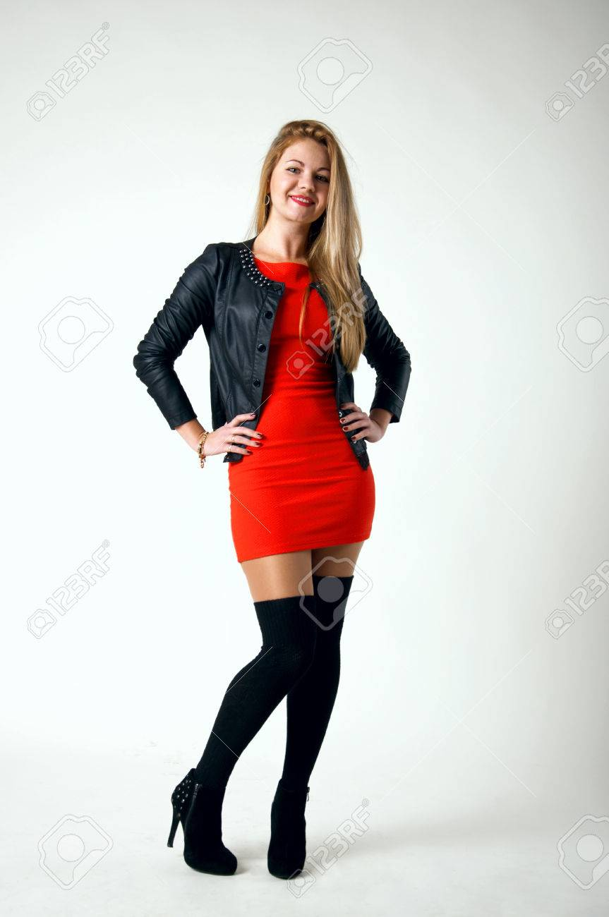 642597033f4 Pretty young blond woman model wearing tight short red dress,..