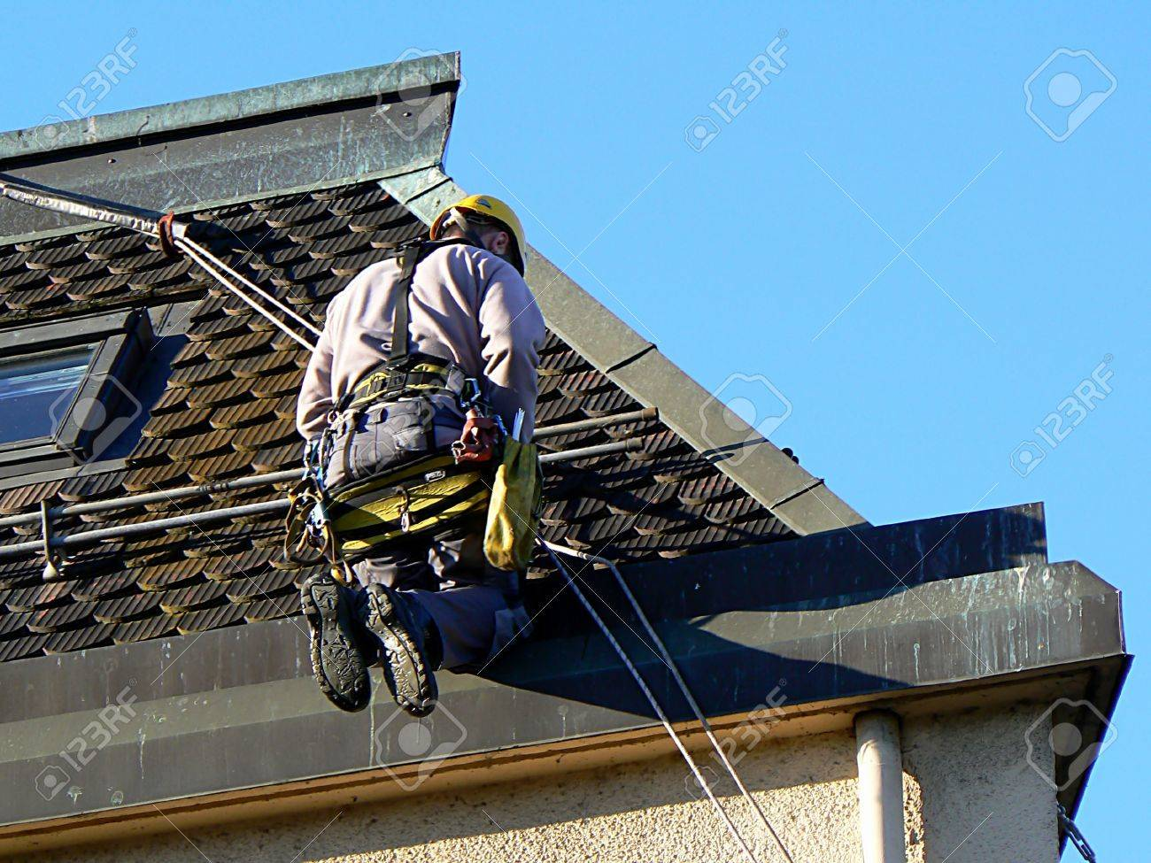 A man sat on a roof - 6711273