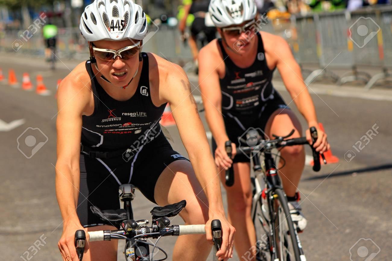 GENEVA, SWITZERLAND - JULY 24 : one unidentified male racing cyclist after the swimm race at the international Geneva Triathlon, on july 24, 2011 in Geneva, Switzerland - 10086095